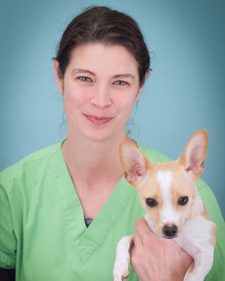 Crystal, Certified Veterinary Technician, with her dog Spike